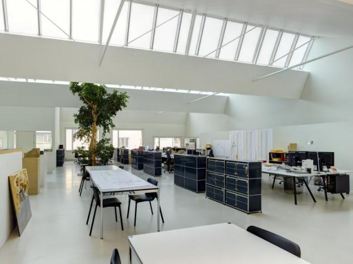 建筑公司现代工业风格办公室设计效果图